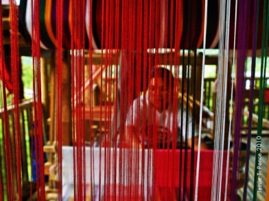 "A ""tubaw"" weaver demonstrates the weaving process on her loom"