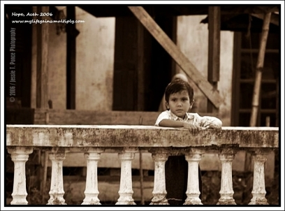 """""""Hope"""", Aceh, Indonesia 2006: A lonesome boy patiently waits for his parents to come home in tsunami-ravaged Aceh."""