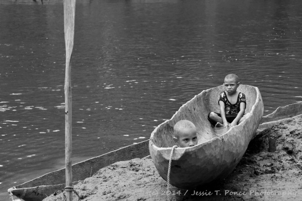 kids on a dugout canoe