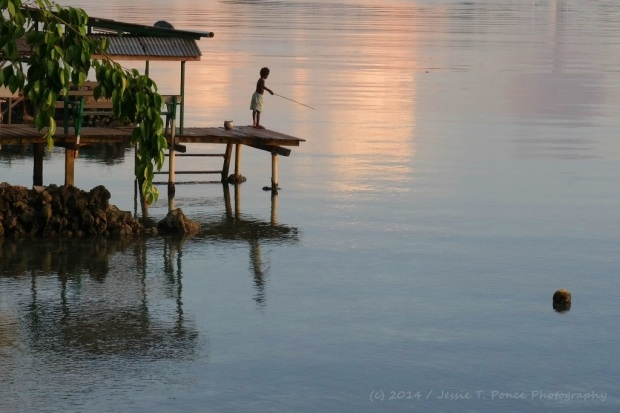 Girl fishing at Buka Passage